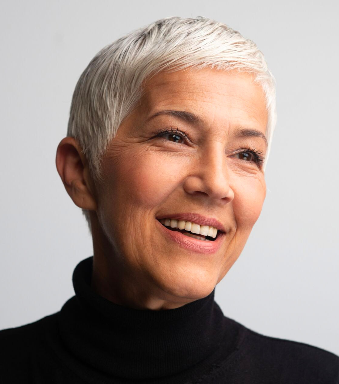 older woman with short hair smiling