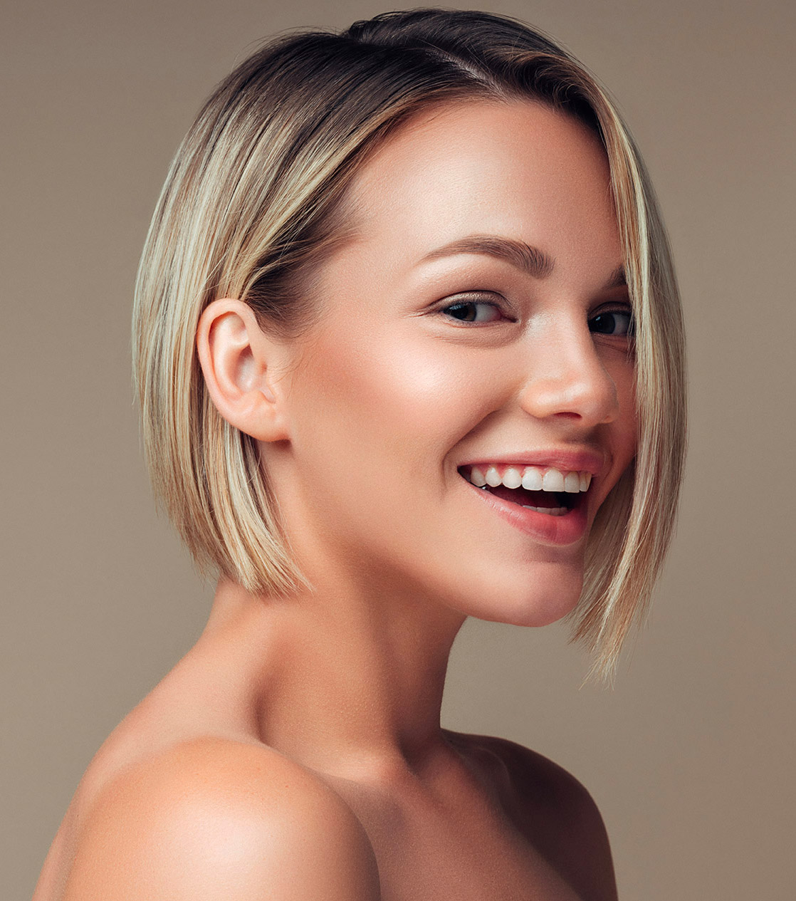 woman with short blonde hair smiling