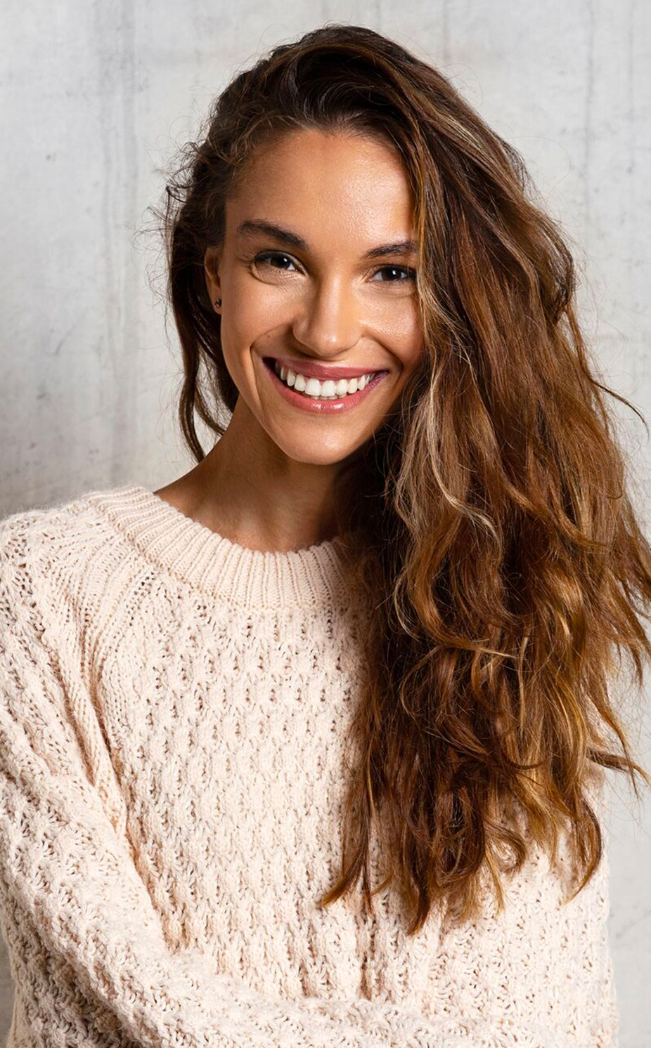 woman smiling in a sweater